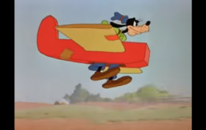 グライダーで空を飛ぼうとするグーフィー