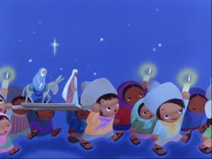 マリアとヨセフの像を運びながら行進するメキシコの子どもたち。